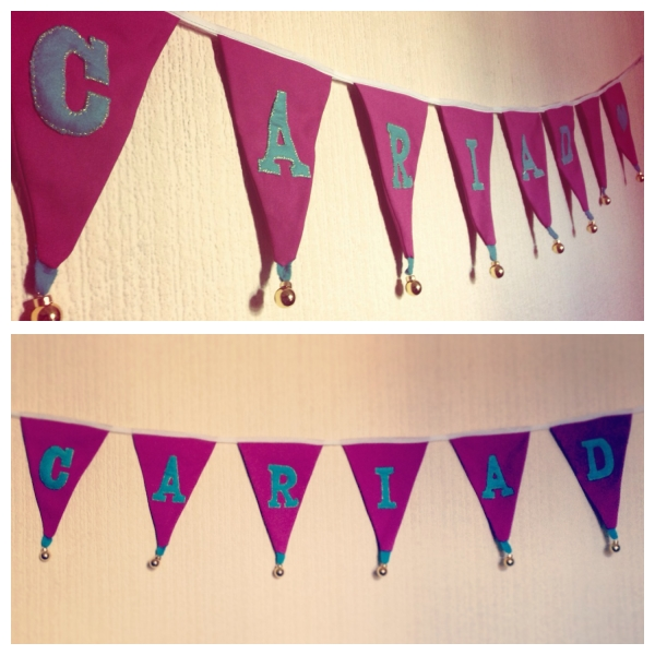 Purple, teal and gold 'Cariad' bunting for wedding party. Jazzed this bunting up by attaching small gold baubles from the IKEA Christmas sale!