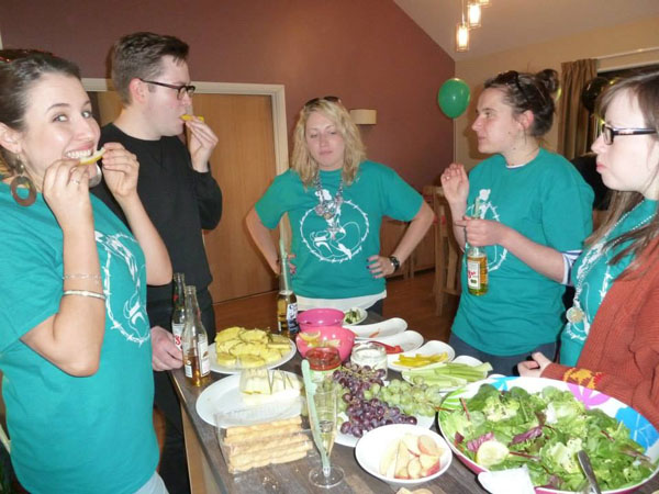 Hen's wearing the hen weekend t shirts while eating the buffet