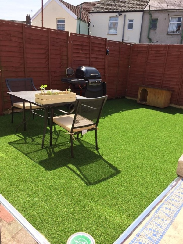 After - Artificial grass and garden furniture in place