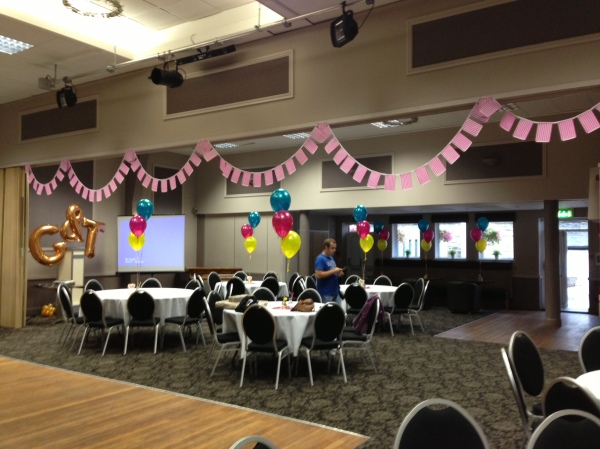 Bunting using pink and white stripe paper bags as pennants. Clever!