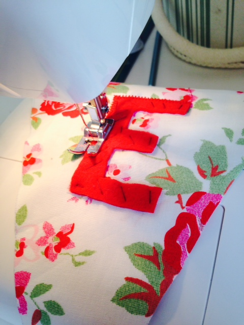 Sew letters onto the pennants
