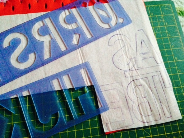 Marking out letters using a stencil