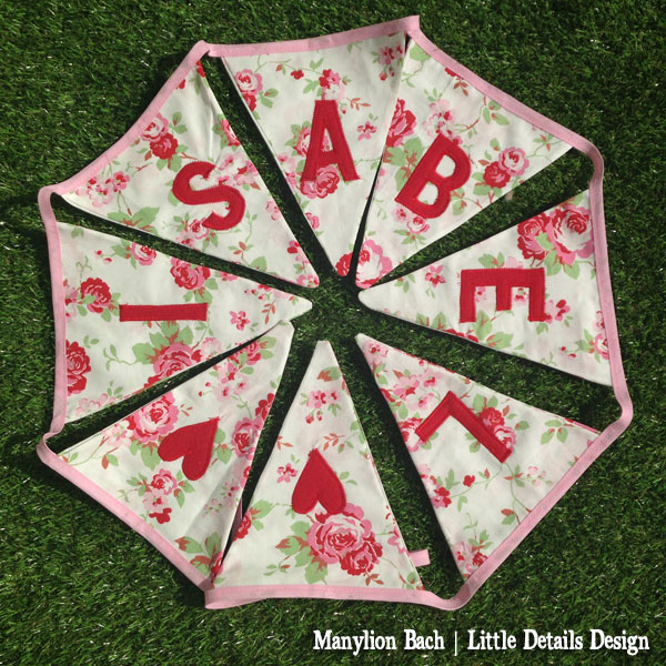 Red, pink and green rose print fabric bunting