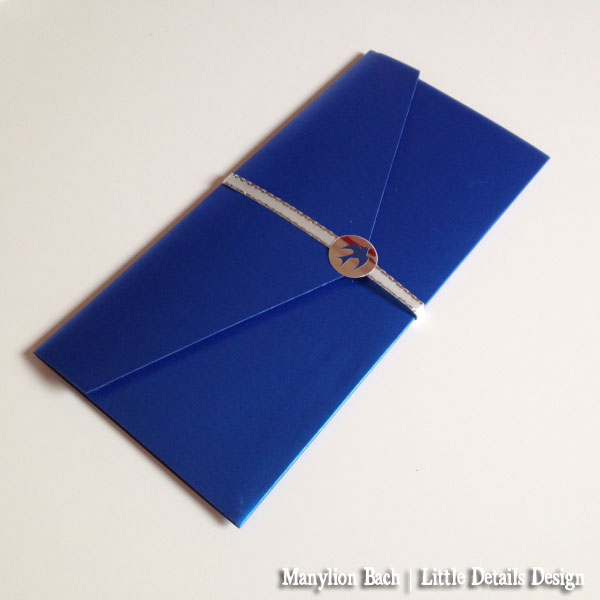 Bluebird Airlines Wedding Invite - Royal Blue Pocketfold with white and silver ribbon belly band and Bluebird silver sticker