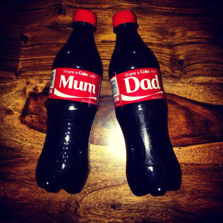 Our pregnancy announcement - Mum and Dad Coca Cola bottles. Scan photos are so cliche!